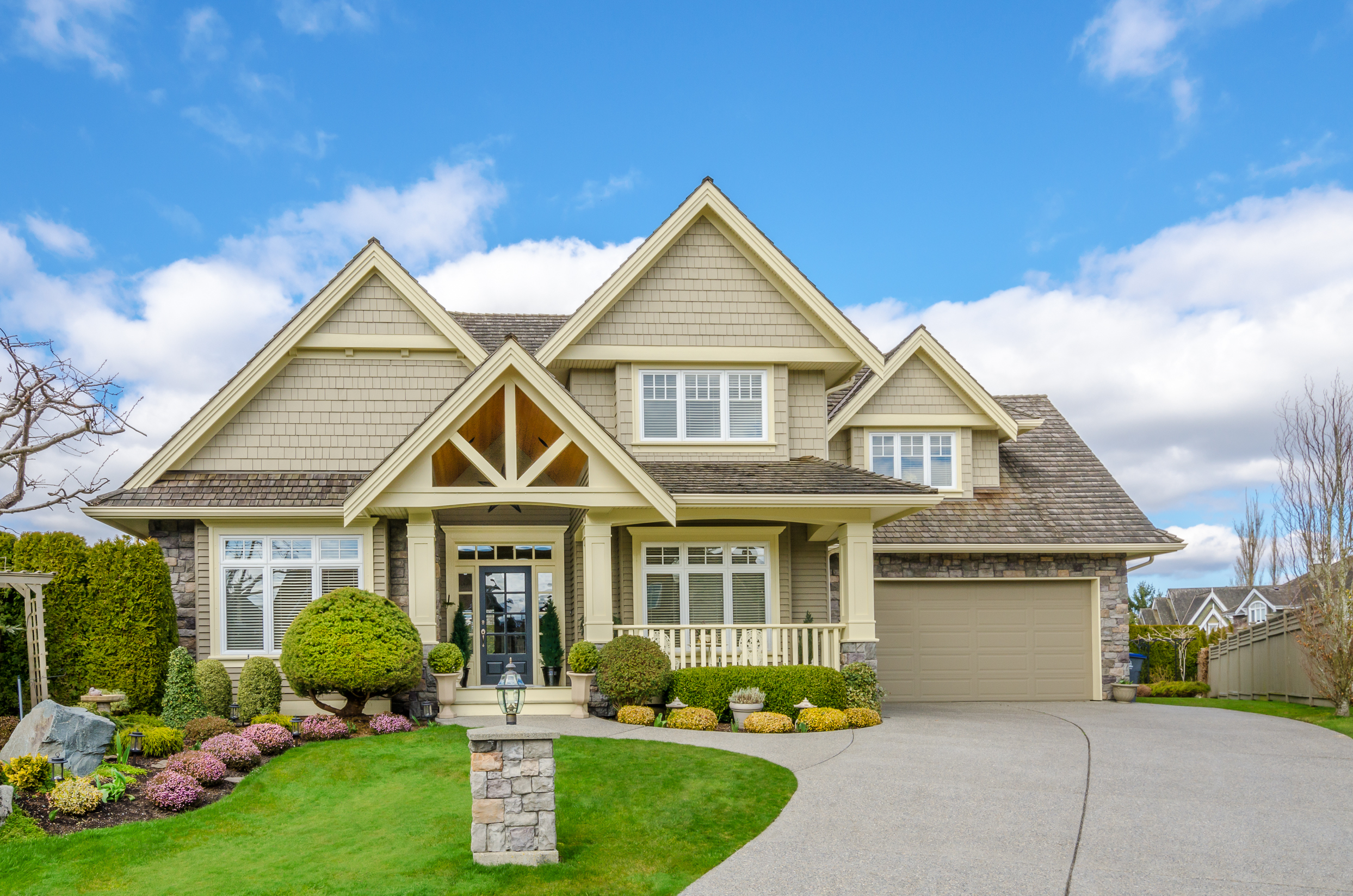 Luxury House With A Two Car Garage And Beautiful Landscaping On